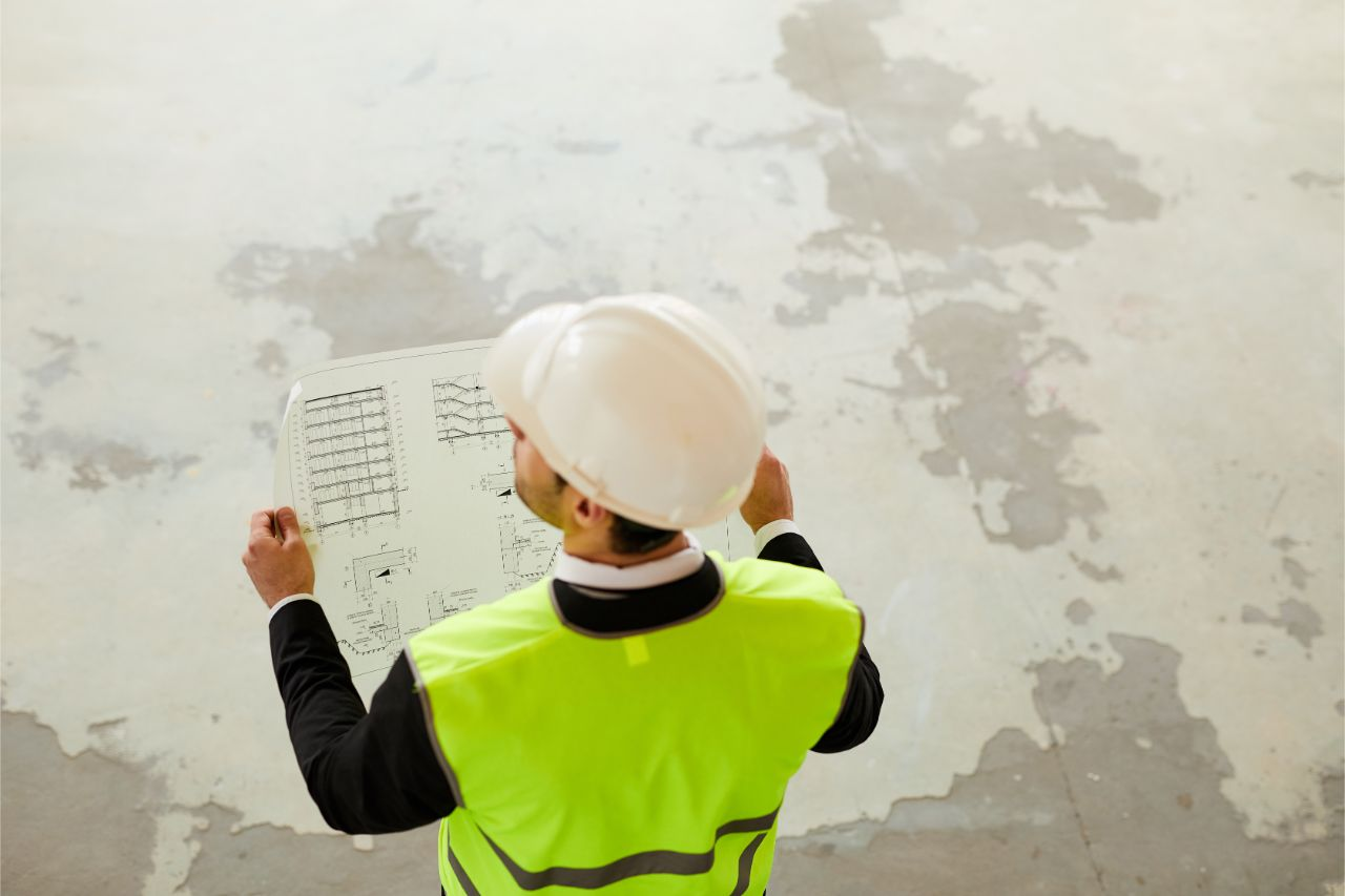 Electrical contractor inspecting electrical system plan of a project