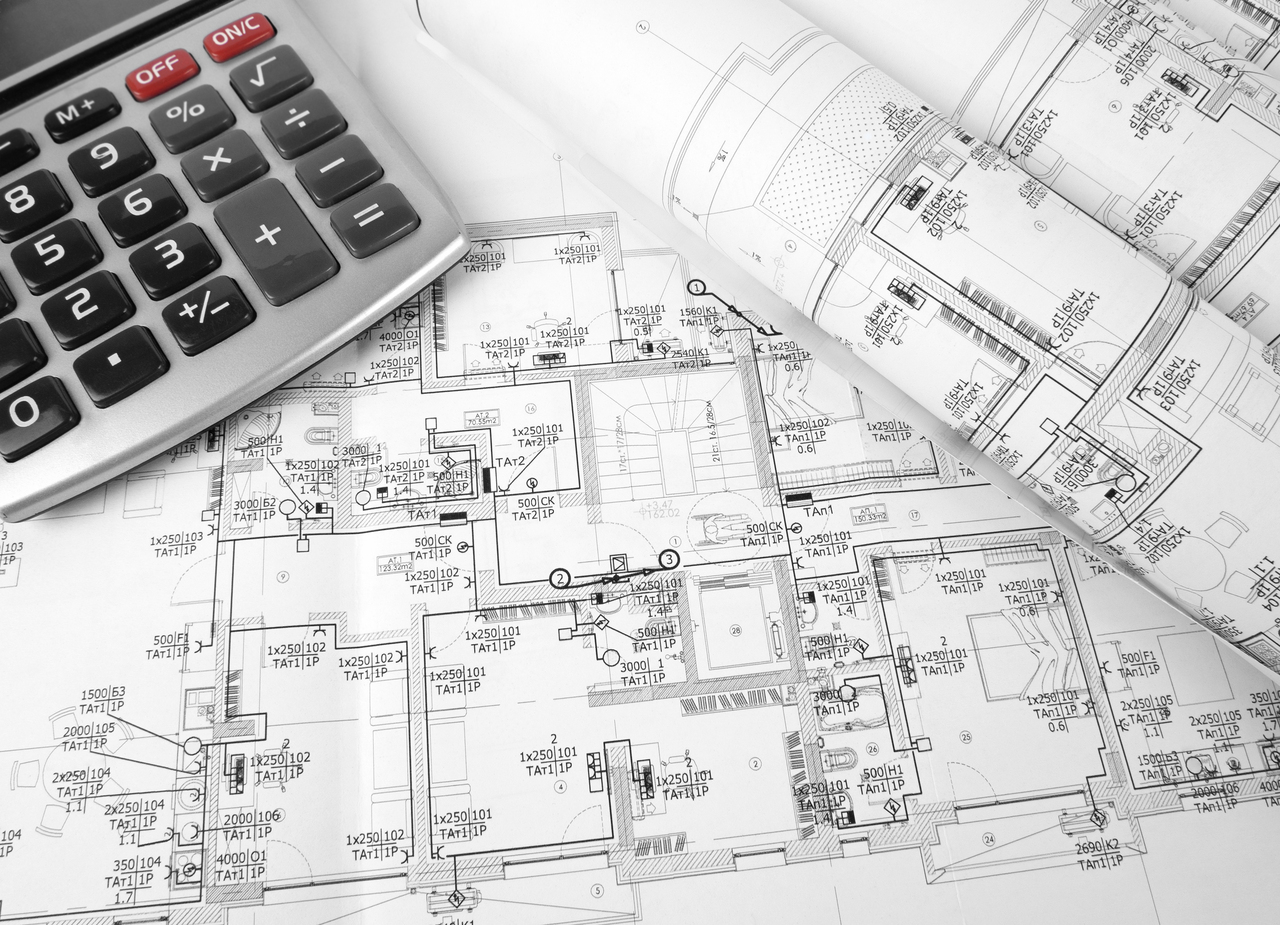 Top view of construction plan with calculator